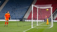 Cowdenbeath's Grant Adam can only look as Chris Duggan's shot hit the back of the net during the SPFL League One play off game between Queen's Park and Cowdenbeath
