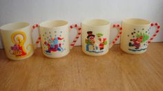 FOUR PCS 1985 STERLING HOUSE  CHRISTMAS PLASTIC MUGS CHILDREN CUPS