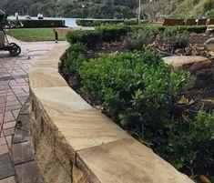 Transforming an old dated brick garden wall with sandstone is simple and effective. Sandstone Cladding, Sandstone Wall, Garden Retaining Wall, Brick Garden, Natural Stone Wall, Natural Stones, Stone Supplier, Australian Garden, Garden Edging