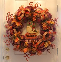"""So you are familiar with the saying """"Go big or go home"""". Well here is a big DIY mesh Thanksgiving wreath that you will have a """"hoot"""" crafting. Follow along with me and let's have some fun.You will need the following materials:1 24"""" work wreath form1 roll of burgundy deco mesh (21"""" wide)3 rolls of 1 1/2"""" wide ribbon, varying patterns, coordinating colors2 Fall leaf floral stems6 Large """"curly"""" floral picksFall yard stakeOf course the mesh goes on first. Starting on the inside..."""