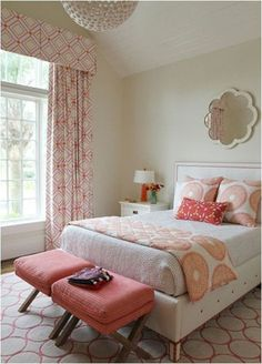 A bedroom by Andrew Howard combines pinks and oranges in multiple geometric patterns, varying the scale of the prints but sticking to those neighboring hues on the color wheel.