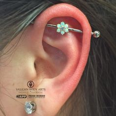Here's a fresh industrial piercing Adam did for Crystal.   She picked out one of our @anatometal 3-hole industrial bars.   Three 16g holes are drilled into the shaft of the bar, so you can pick out any 16g threaded ends and create a nearly endless array of looks.   Crystal went with a yellow gold flower in the center and plans on throwing some diamonds on either side a little later.   Great choice, Crystal. It looks great on you!
