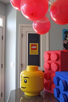 Lego party idea and printable (not free). I LOVE the boxes made with crate paper and matching tissue paper! idea to hold down lego colored balloons Lego Movie Party, Ninjago Party, Kids Birthday Themes, Lego Birthday Party, Giant Lego Blocks, Pokemon Party, Party In A Box, Party Time, Lego Van