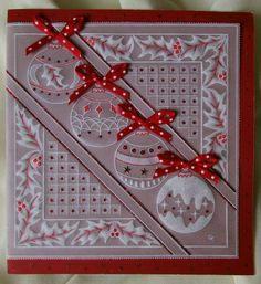 Christmas Baubles card, which I traced with white Tinta ink and a red gel pen, and then enhanced the dots in the design using a glue pen, sprinkled with red glitter.