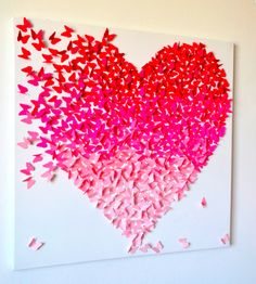 This beautiful Ombre Butterfly Heart artwork is made from Hundreds of 1'' butterflies in shades of pink come together in flight to form a heart. Butterflies are made from quality cardstock, and have been attached one by one with professional, strong double sided tape to an artist's canvas painted white. Inspiration perhaps?