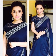 Elegant navy blue saree and blouse. Love the earrings too! Indian fashion.