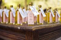 Wedding favors and seating assignments. Love the idea of little bottles of olive oil. A Lowcountry Wedding - Charleston, Myrtle Beach & Hilton Head's Favorite Wedding Resource: Favors {Wedding Details} Wedding Favor Crafts, Wedding Favours, Party Favors, Wedding Gifts, Shower Favors, Diy Favours, Wedding Decoration, Wedding Things, Myrtle Beach Hilton