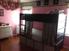 SO doing this to my daughter's bunk bed.  How simple...  Pick out material, add Velcro (so you can wrap the curtain around the bar on the top bunk), and attach.  Slide off to the sides.  Ooo, think I'll make some curtain tie-backs too.  Hmmmm...