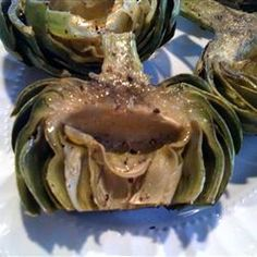 Grilled Garlic Artichokes. So good! For me, I would scale back the sauce to half, since I smoke mine on the Traeger and did not need anything for dipping!