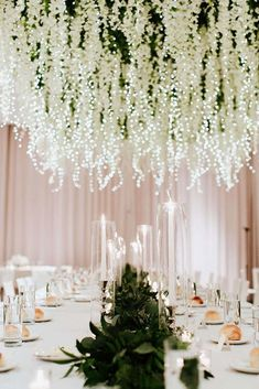 Most Magical Hanging Floral Installation With Fairy Lights ~ so beautiful! Stems Floral Design + Production intertwined fairy lights among 100 square feet of hanging white wisteria which was suspended above a long table. Wedding Table Centerpieces, Reception Decorations, Event Decor, Table Decorations, Diy Decoration, Wedding Columns, Wedding Reception, Wisteria Wedding, Wedding Flowers