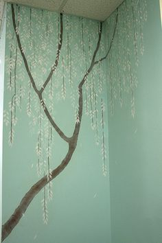Tree mural for bedroom but with light purple background and wisteria hanging off the branches.