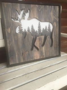 MOOSE SILHOUETTE/Forest Sign/Woodland Animals/Cabin Decor/Man Cave Decor/Rustic Decor/Hunting Decor DETAILS: * A super unique moose silhouette to hang as a focal point in your home! * Measures approximately 24 x 24 * Includes two triangle hangers and a protective polycrylic top coat