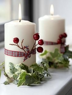 sweet and simple way to spice up a plain white candle for christmas - just add ribbon, red berries, and greenery.
