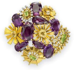 A MULTI-GEM, DIAMOND AND GOLD BROOCH, BY JEAN SCHLUMBERGER.  Designed as a floral cluster, set with pear, cushion and oval-cut amethysts, interspersed with sculpted gold blossoms, each centering upon a variously shaped peridot or yellow sapphire, with collet-set diamond accents, mounted in yellow and white gold, circa 1950, in a Schlumberger Inc. black velvet fitted case. Signed Schlumberger Inc. for Jean Schlumberger