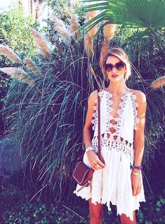 Rosie Huntington Whiteley in a crocheted white halter dress by Chloe