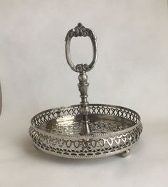silver condiment stand English silver tableware silver footed small round tray with handle punched silver storage tray with handle by GlyndasVintageshop on Etsy