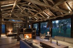 The Barn House – Galpon Ranco farmhouse wood interior - fireplace / living room http://www.woodz.co/galpon-ranco/