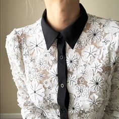 Favorite lace patchwork daisies top .tre chic Crafted from delicate lace daisies pattern blouse. This season one of a kind. Chic and sweetest blouse . Tops Button Down Shirts