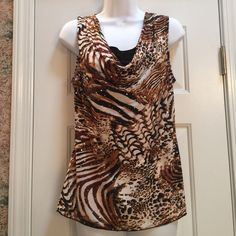 Animal Print Top Softly sexy animal print top has a cowl neckline with a black insert for coverage Very cool and flowing at the bottom Made of 96% polyester & 4% spandex Worn a couple of times and outgrown Excellent pre-loved condition Brittany Black Tops