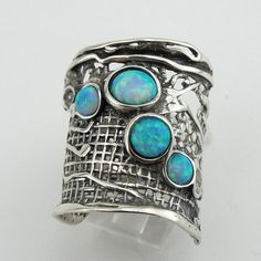 Magnificent NEW silver gorgeous Ring from Hadar Jewelry Nets collection with five round Opal stones (6mm-3mm) inlaid in 24mm wide sterling silver