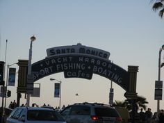 Pier's entrance sign at sunset