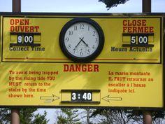 Hopewell Rocks tide clock.  Hopewell Rocks, Fundy National Park, New Brunswick, Canada.