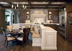 Kitchen bar/island with casual breakfast dining in middle.  Oohlala!!!!  Love it!!