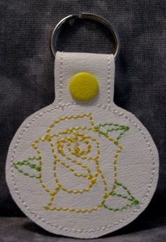 26 - Yellow Rose on White Vinyl and Yellow Snap Tab Key Fob