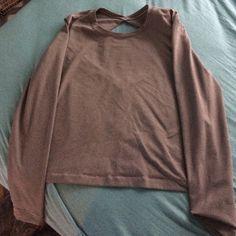 grey lulu lemon open back long sleeve has an open back, worn 2 times perfect condition lululemon athletica Tops Tees - Long Sleeve