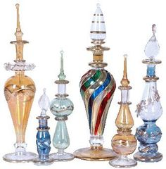 6 pc Mix LOT of EGYPTIAN mouth Pyrex Glass Perfume Bottles CraftsOfEgypt http://smile.amazon.com/dp/B005IXE4VU/ref=cm_sw_r_pi_dp_JYzdub0X78BP2