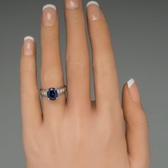 This beautiful blue sapphire ring is crafted of platinum and features channel set round brilliant diamonds set in the shoulders of the band. The ring is currently a size 4.5 and we offer complimentary resizing so that the ring is ready to wear or use for a memorable proposal.