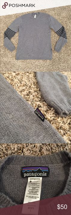Men's Patagonia Sweater Men's Patagonia sweater. It is grey with charcoal grey stripes on the arms. It is 80% lambs wool and 20% nylon. Patagonia Sweaters Crewneck