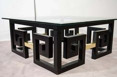 View this item and discover similar  for sale at 1stdibs - A vintage coffee table with a clear glass top and an ebonized wood Greek-key form base with brass accents. Reduced from: $6,850