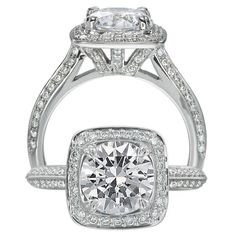 Masterwork diamond engagement ring featuring a cushion halo with a round cut centerstone with micropavé diamonds surrounding the centerstone, on the mounting with two rows on a knife edge shank.