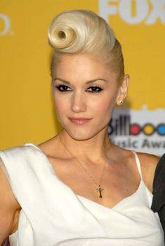 Gwen Stefani rockin' a pseudo Elvis do.