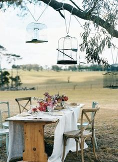 Will throw an outdoor dinner party just like this one day, maybe swap birdcages for mason jars with tea lights