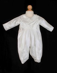 Your little prince will look so angelic in this silk boys 1 piece christening set. Features pleated silk pants and silk collar on bodice. The bonnet included adds the perfect finishing touch to the outfit. The Sweetie Collection uses only the finest imported fabrics, embroideries, beadwork and lace. Items are special ordered directly from the manufacturer. Please check this before ordering to ensure enough time before event and sizes and color are correct on your order.