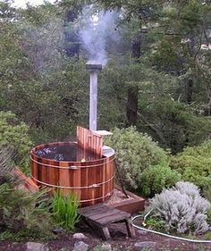 wood burning hot tub This is so awesome! Not only are they less expensive to purchase and maintain than your every day hot tub they are also much more fun. Very fitting for a country home setting :-)