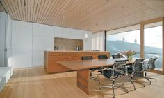 Note in the kitchen the contrast between white (storage) and wood (island) volumes Conference Room, Modern Kitchens, Storage, Wood, Interior, Table, Contrast, House, Island