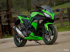 We put this 2013 Kawasaki Ninja 300 head to head with the Honda CBR250R to find out which entry bike reigns supreme.
