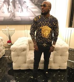 Jeezy Wears Versace Shirt, Belt, Shoes and Dita Sunglasses  For New Years, rapper Jeezy was spotted rocking a Versace long sleeve t-shirt, Versace oval medallion vitello belt ($495) and Versace suede stamped vitello car shoes ($795). He was also rocking Dita sunglasses.