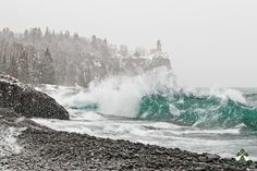 """Winter Storm at Split Rock Lighthouse""<br /> <br /> The lighthouses on the Great Lakes were built to safely guide ships through storms such as this. Now standing silent yet picturesque, they are proud ambassadors of a bygone era."