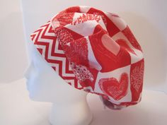 Hearts, hearts, hearts! Red and Pink hearts make a very charming pattern for the fabric of this bouffant surgical scrub hat. It is easy care 100%