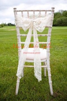 Vintage ivory lace chair sash by Fuschia on shabby chic style chair. The perfect touch for a vintage / rustic style wedding.