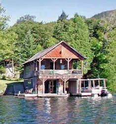 Nice combination log cabin design and boathouse