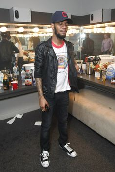 Kid Cudi - hat, t-shirt, leather jacket, jeans, converse
