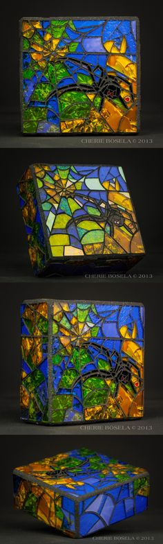 """Title: Black Widow Artist: Cherie Bosela Size: 4.25"""" x 4.25"""" x 1.75"""" Medium: mosaic made from stained glass and my original photography underneath"""