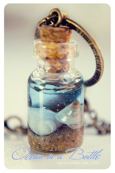 Ocean in a Bottle necklace. Vial necklace with Shells mini Glass bottle necklace. Bottle Jewelry, Bottle Charms, Bottle Art, Resin Jewelry, Beer Bottle, Jewellery, Glass Jewelry, Vodka Bottle, Mini Glass Bottles