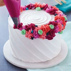 Bright Flower Ring Cake Topped with a crown of buttercream flowers, this any occasion cake can be used for birthdays, anniversaries, showers and so much more. Cake Decorating Designs, Cake Decorating Techniques, Simple Cake Decorating, Cookie Cake Designs, Decorating Supplies, Decorating Ideas, Icing Flowers, Buttercream Flowers, Cake With Flowers