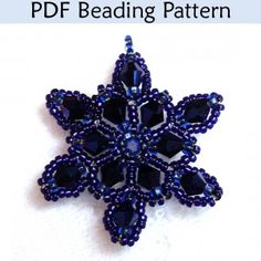 """""""Crystal Snowflake"""" Pendant PDF Beading Pattern I made lots of snowflakes around Christmas I didn't think of using dark colors but now I have to try it!"""